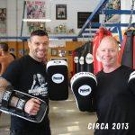 Bruce Townhill & John Wayne Parr holding Curved Thai Pads