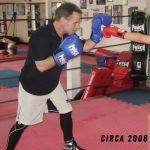 Boxing coach wearing Coach Mitts Circa 2008
