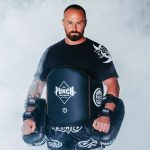Coach wearing the Black Diamond Muay Thai Belly Pad